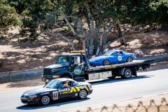 Miata being towed in on the Laguna Seca Raceway at 2016 MRLS